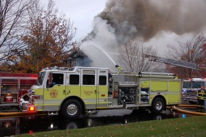 Engine 5-1 operating the deck gun at a structure fire